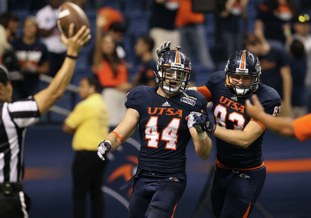 UTSA's Steven Kurfehs (44) gets congratulated by teammate Cole Hubble (83) after Kurfehs scored a touchdown on a fumble recovery against San Jose State in the second half at the Alamodome on Saturday, Oct. 20, 2012. Photo: Kin Man Hui, Express-News / © 2012 San Antonio Express-News