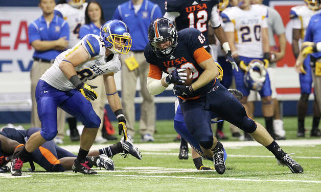 UTSA's Cole Hubble tries to push for extra yardage against San Jose State in the second half at the Alamodome on Saturday, Oct. 20, 2012. Photo: Kin Man Hui, Express-News / © 2012 San Antonio Express-News