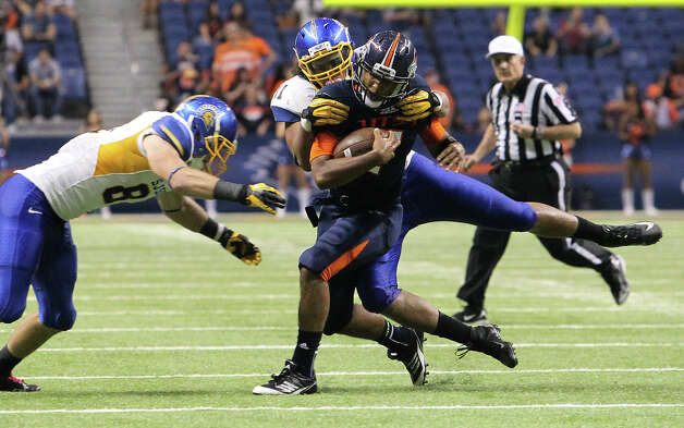 UTSA quarterback Ryan Polite gets hauled down by San Jose State's Jeffrey Telles (41) and James Orth (81) in the second half at the Alamodome on Saturday, Oct. 20, 2012. Photo: Kin Man Hui, Express-News / © 2012 San Antonio Express-News