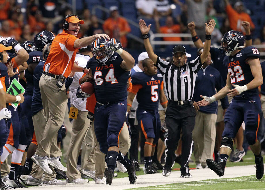 San Jose State 52 - UTSA 24: UTSA's Franky Anaya (64) gets congratulated by graduate assistant coach Benny Morrison after Anaya recovered a fumble against San Jose State in the first half at the Alamodome on Saturday, Oct. 20, 2012. Photo: Kin Man Hui, Express-News / © 2012 San Antonio Express-News
