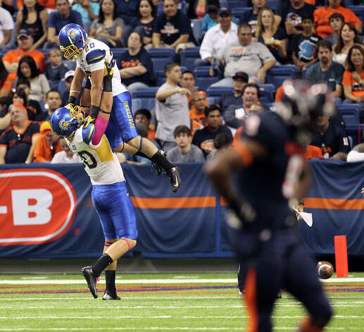 San Jose State's Chris Kearney (20) gets lifted up by teammate Max MIller (80) after the Spartans recovered a botched punt snap for a touchdown against UTSA in the first half at the Alamodome on Saturday, Oct. 20, 2012. Photo: Kin Man Hui, Express-News / © 2012 San Antonio Express-News