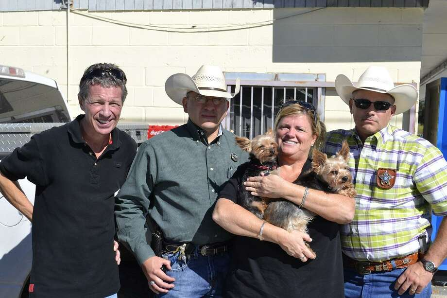 Private investigator Dan Phillips (from left), Atascosa sheriff's Sgt. Max Peralta and sheriff's Sgt. Wayne Stratton gather with Peggy Riley and her dogs, Baxter and Cooper. Photo: Courtesy Photo / Peggy Riley / COURTESY PEGGY RILEY