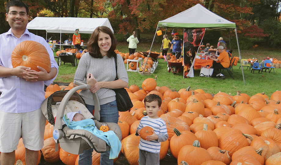 Saleem, Caroline, Alison and Alistair Mukhtar, of Westport, with the pumpkins they selected from the patch Saturday at the St. Luke Harvest Festival. Photo: Mike Lauterborn / Westport News contributed