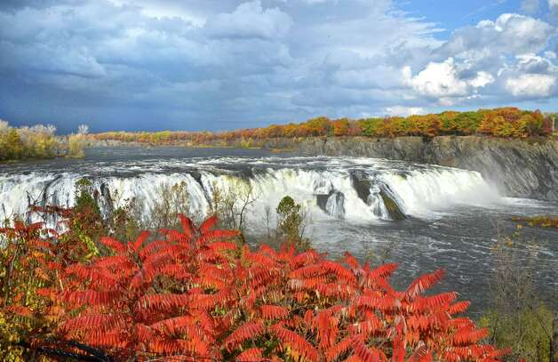 Yesterday's record rainfall turns the the Cohoes Falls on the Mohawk River into a spectacular backdrop for the 3rd Annual Falls View Park Jack-o-Lantern Jubilee at Brookfield Falls View Park in Cohoes Saturday Oct. 20, 2012.  (John Carl D'Annibale / Times Union) Photo: John Carl D'Annibale / 00019735A