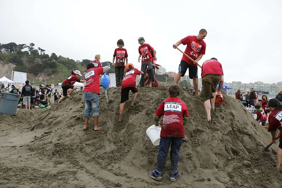 On October 20, 2012 in San Francisco, Calif. team members of McKinley Elementary school work together on creating an olympian sand sculpture depicting olympic sporting events like swimming, javelin throwing, and hurdles. Hundreds of people turned out for the annual LEAP Sand Castle Contest at ocean beach near Balboa and the Great Highway Saturday. Teams of elementary schools and their sponsors started work at 10 a.m. to be judged and given awards by 3 p.m. Photo: Rashad Sisemore, The Chronicle