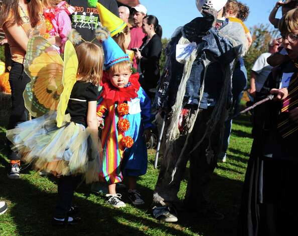 Four-year-old Nathan Horn, of Stratford, marches in the costume parade during the annual Great Pumpkin Festival Saturday, Oct. 20, 2012 at Boothe Memorial Park in Stratford, Conn. Photo: Autumn Driscoll / Connecticut Post