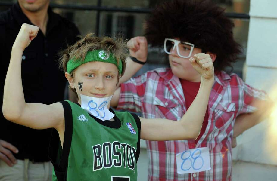 Jacob Beller, 10, and Zachary Smith get ready for the costume parade during the annual Great Pumpkin Festival Saturday, Oct. 20, 2012 at Boothe Memorial Park in Stratford, Conn. Photo: Autumn Driscoll / Connecticut Post