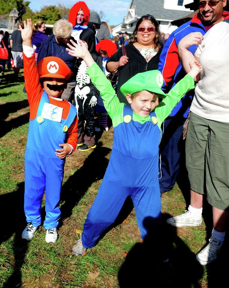 Mario and Luigi, Nelson Villafane, 7, and Carter Fetchin, 6, march in the costume parade during the annual Great Pumpkin Festival Saturday, Oct. 20, 2012 at Boothe Memorial Park in Stratford, Conn. Photo: Autumn Driscoll / Connecticut Post
