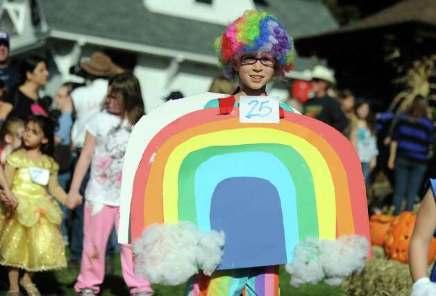 Magnolia Hammel, 8, of Stratford, marches in the costume parade during the annual Great Pumpkin Festival Saturday, Oct. 20, 2012 at Boothe Memorial Park in Stratford, Conn. Photo: Autumn Driscoll / Connecticut Post