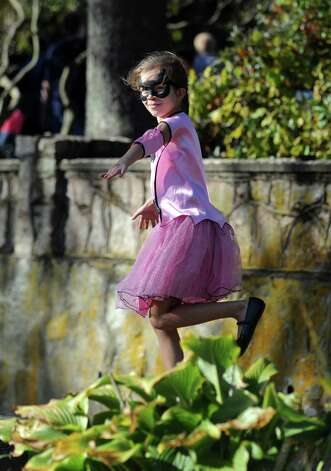 Isabella Zukowski, 7, of Stratford, strikes a pose at the annual Great Pumpkin Festival Saturday, Oct. 20, 2012 at Boothe Memorial Park in Stratford, Conn. Photo: Autumn Driscoll / Connecticut Post