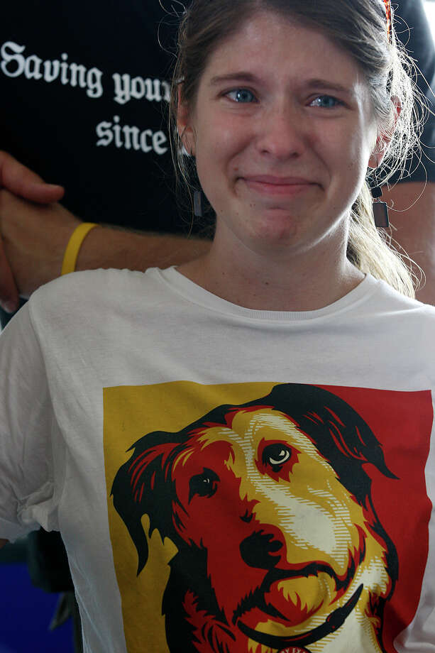 Alamo Rescue Friends founder Virginia Davidson, 28, tears up as she talks about the reasons that drove her to start the nonprofit — which transports dogs from high-kill shelters to no-kill shelters in another state — on Aug. 29, 2010. Photo: Jerry Lara, San Antonio Express-News / glara@express-news.net