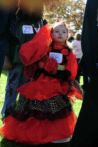 Four-year-old Alexis Vargas, of Ansonia, marches in the costume parade during the annual Great Pumpkin Festival Saturday, Oct. 20, 2012 at Boothe Memorial Park in Stratford, Conn. Photo: Autumn Driscoll / Connecticut Post