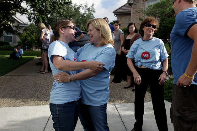 Alamo Rescue Friends founder Virginia Davidson (left) hugs Animal Care Service Advisory Board member Rita Braeutigam, Tuesday, Aug. 31, 2010, before a previous dog transport. Davidson and her husband, Greg Kidd, started ARF after learning of the stray problem while living a year-and-a-half in San Antonio. Now residing in Connecticut, the couple is transporting more than a dozen dogs from ACS to the Humane Society of Greater Nashua, N.H., a no-kill shelter. Photo: Jerry Lara, San Antonio Express-News / glara@express-news.net
