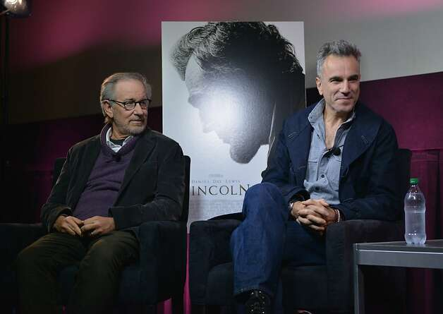 "Steven Spielberg (left) and Daniel Day-Lewis talk after an Oct. 10 ""Lincoln"" showing in New York. Photo: Bryan Bedder, Getty Images For Walt Disney Stu"