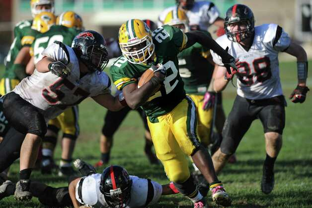 Trinity Catholic's Shaquan Howsie carries the ball for a touchdown during Saturday's football game against Fairfield Warde at Trinity Catholic High School in Stamford, Conn., on October 20, 2012. Photo: Lindsay Niegelberg / Stamford Advocate