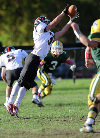 Fairfield Warde's T.J. Gallagher makes a catch during Saturday's football game at Trinity Catholic High School in Stamford, Conn., on October 20, 2012. Photo: Lindsay Niegelberg / Stamford Advocate