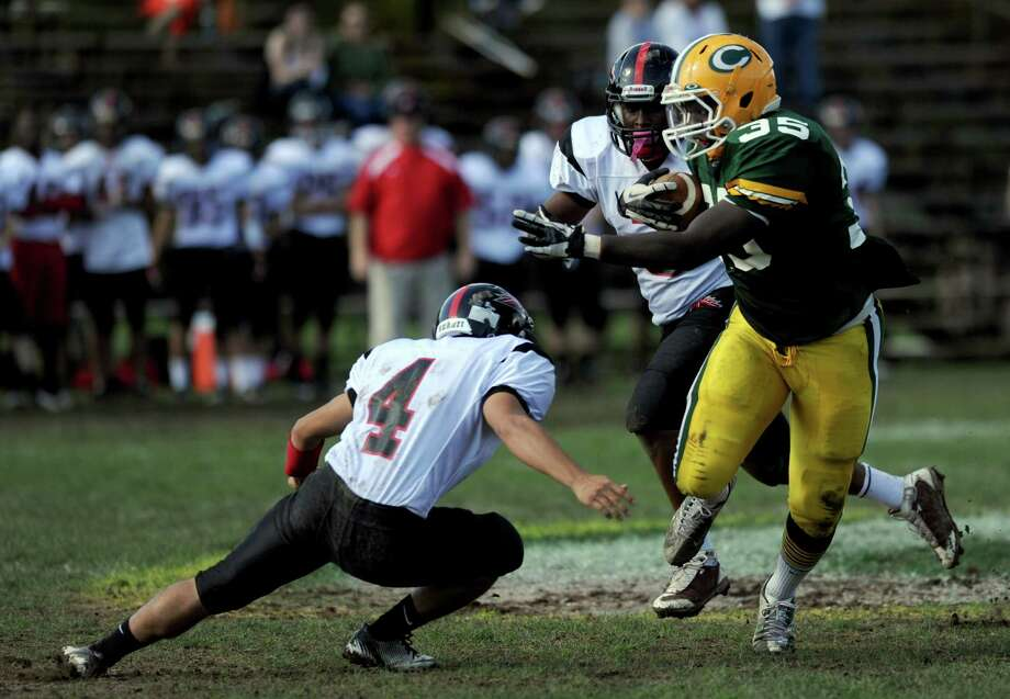 Trinity Catholic's Shawn Brown makes a 52-yard touchdown run during Saturday's football game against Fairfield Warde at Trinity Catholic High School in Stamford, Conn., on October 20, 2012. Photo: Lindsay Niegelberg / Stamford Advocate