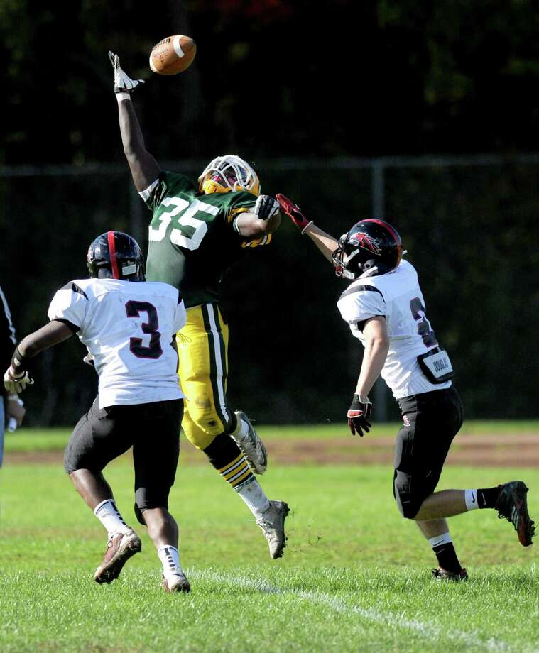 Trinity Catholic's Shawn Brown reaches for a pass that fell incomplete during Saturday's football game against Fairfield Warde at Trinity Catholic High School in Stamford, Conn., on October 20, 2012. Photo: Lindsay Niegelberg / Stamford Advocate