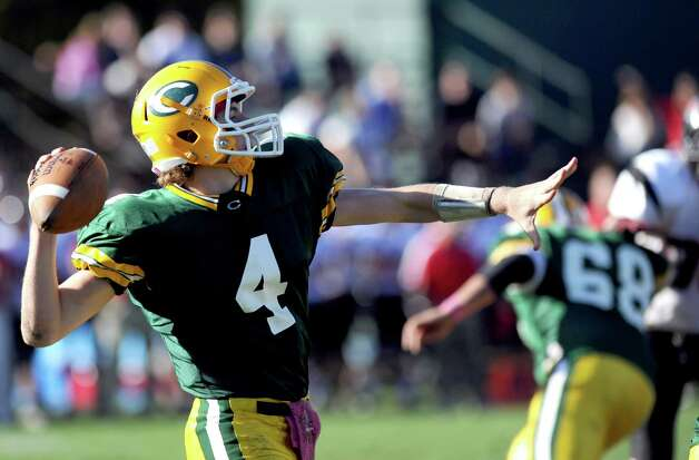 Trinity Catholic's Danny O'Leary throws a pass during Saturday's football game against Fairfield Warde at Trinity Catholic High School in Stamford, Conn., on October 20, 2012. Photo: Lindsay Niegelberg / Stamford Advocate