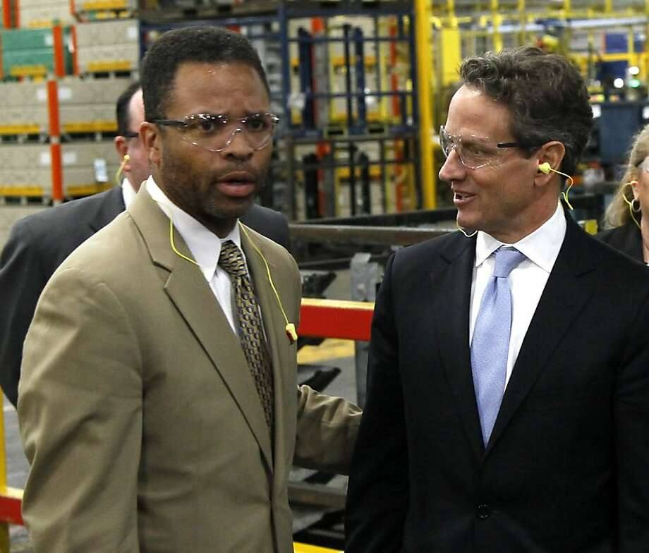 Rep. Jesse Jackson Jr. (left) meets with Treasury Secretary Timothy Geithner at a Ford plant in Chicago Heights in April. Jackson's leave began in June. Photo: Charles Rex Arbogast, Associated Press