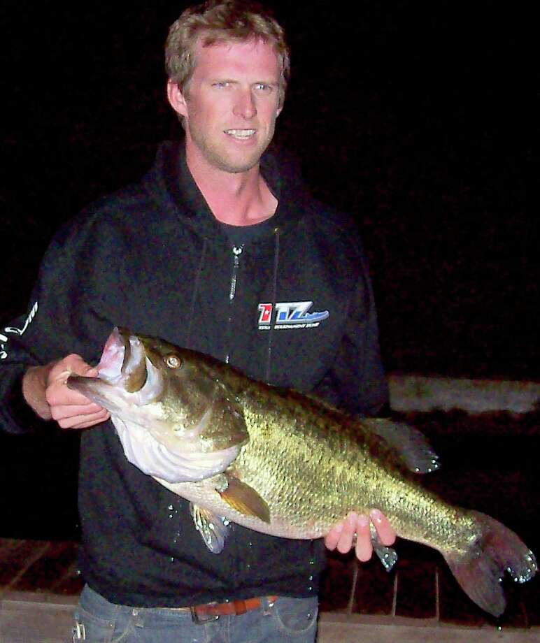 Angler Bennett Cowan used a homemade, 17-inch plastic worm to catch this 14.28-pound largemouth from Lake Austin on Oct. 16. The fish is the first ShareLunker program entry of the 2012-13 season. Photo: Picasa