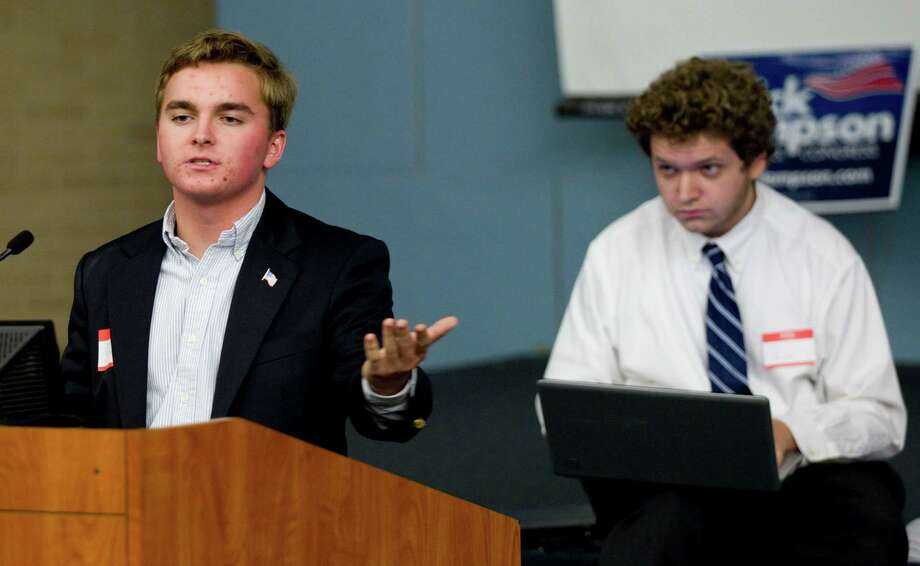Jared Naylor, of St. Mary's Hall in San Antonio, left, debates gun control with Taylor Johnston, of Clear Creek High School, Saturday at University of Houston. Photo: Brett Coomer / © 2012 Houston Chronicle