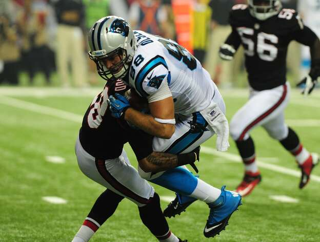 Greg Olsen (88) of the Carolina Panthers is tackled by Thomas DeCoud (28) of the Atlanta Falcons at the Georgia Dome on September 30, 2012 in Atlanta, Georgia. (Photo by Scott Cunningham/Getty Images)