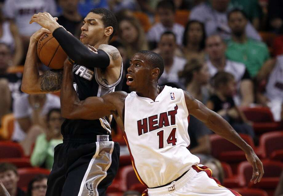 Miami Heat's Terrel Harris, right, tries to stop San Antonio Spur's Danny Green, left, from taking a shot during the second half of an NBA basketball game in Miami, Saturday, Oct. 20, 2012.  (J Pat Carter/Associated Press)