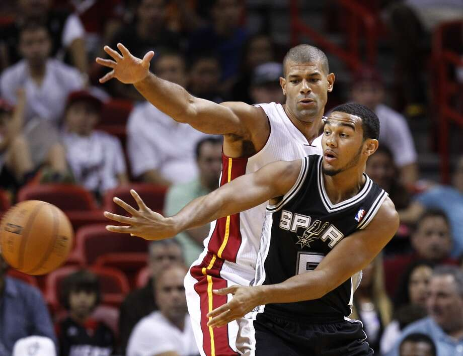 Miami Heat's Shane Battier, top, forces San Antonio Spur's Cory Joseph (5) to pass off the ball during the first half of an NBA basketball game in Miami, Saturday, Oct. 20, 2012.  (J Pat Carter/Associated Press)