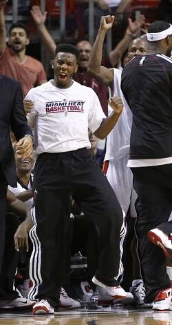 Miami Heat's Norris Cole celebrates during the second half of an NBA basketball game against the San Antonio Spurs in Miami, Saturday, Oct. 20, 2012. The Heat won 104-101. (J Pat Carter/Associated Press)