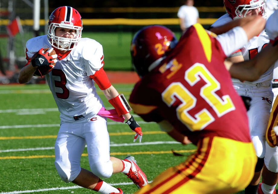 St. Joseph's #22 Dylan Ryan tries to reach New Canaan's #3 Jack Gilio, during boys football action in Trumbull, Conn. on Saturday October 20, 2012. Photo: Christian Abraham / Connecticut Post