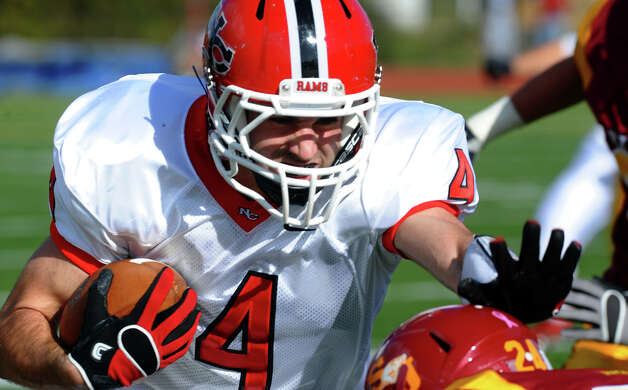 New Canaan's #4 Ryan Minaglia carries the ball, during boys football action against St. Joseph in Trumbull, Conn. on Saturday October 20, 2012. Photo: Christian Abraham / Connecticut Post