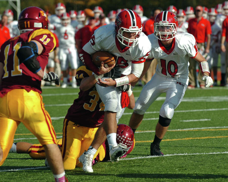 New Canaan QB Nick Cascione carries the ball toward the endzone to score a touchdown, during boys football action in Trumbull, Conn. on Saturday October 20, 2012. Photo: Christian Abraham / Connecticut Post