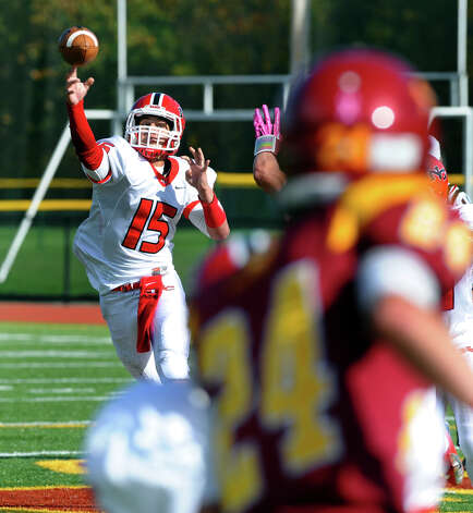 New Canaan QB Nick Cascione tosses a pass, during boys football action against St. Joseph in Trumbull, Conn. on Saturday October 20, 2012. Photo: Christian Abraham / Connecticut Post