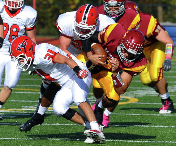 during boys football action in Trumbull, Conn. on Saturday October 20, 2012. Photo: Christian Abraham / Connecticut Post