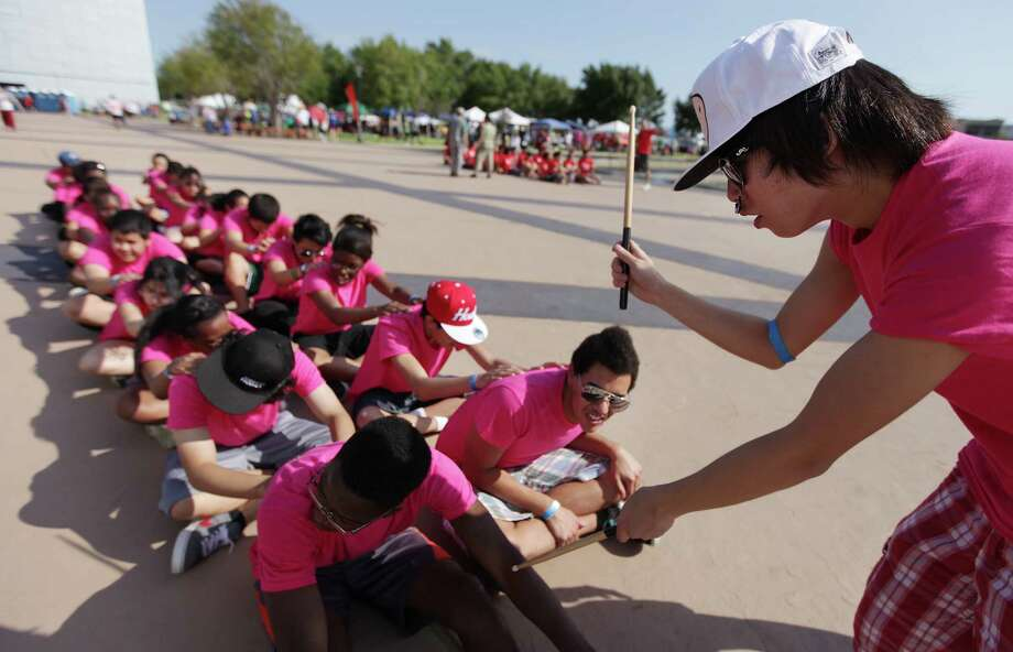 Drummer Allen Wei keeps count for the Sharpstown International School Team as they practice paddling in unison. Photo: Mayra Beltran, Houston Chronicle / © 2012 Houston Chronicle