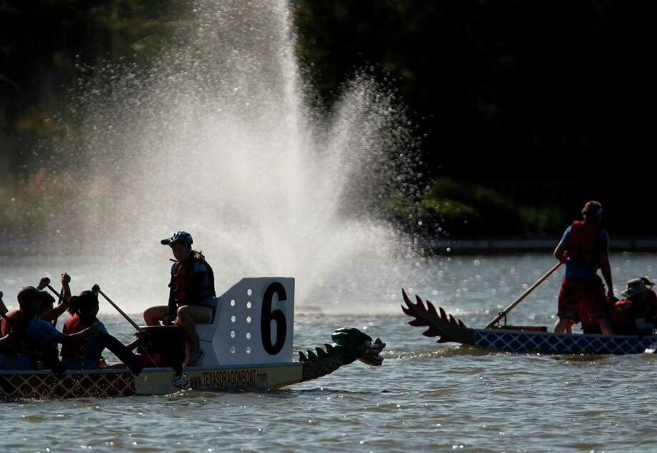 The semi-finals start at 2 p.m., and the race finals are at 3:30, and the public is welcome to attend The 8th Annual Gulf Coast International Dragon Boat Regatta starting at 8:30 p.m. at Brooks Lake on Sunday in Sugar Land. Photo: Mayra Beltran, Houston Chronicle / © 2012 Houston Chronicle