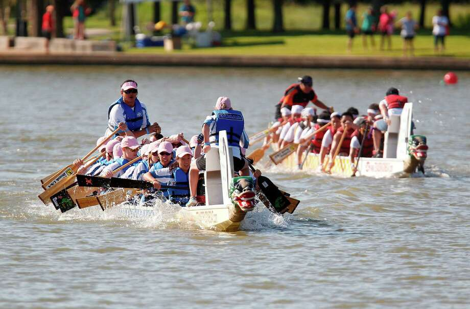 Team Exmar Offshore competes in the first round of races during The 8th Annual Gulf Coast International Dragon Boat Regatta. Photo: Mayra Beltran, Houston Chronicle / © 2012 Houston Chronicle