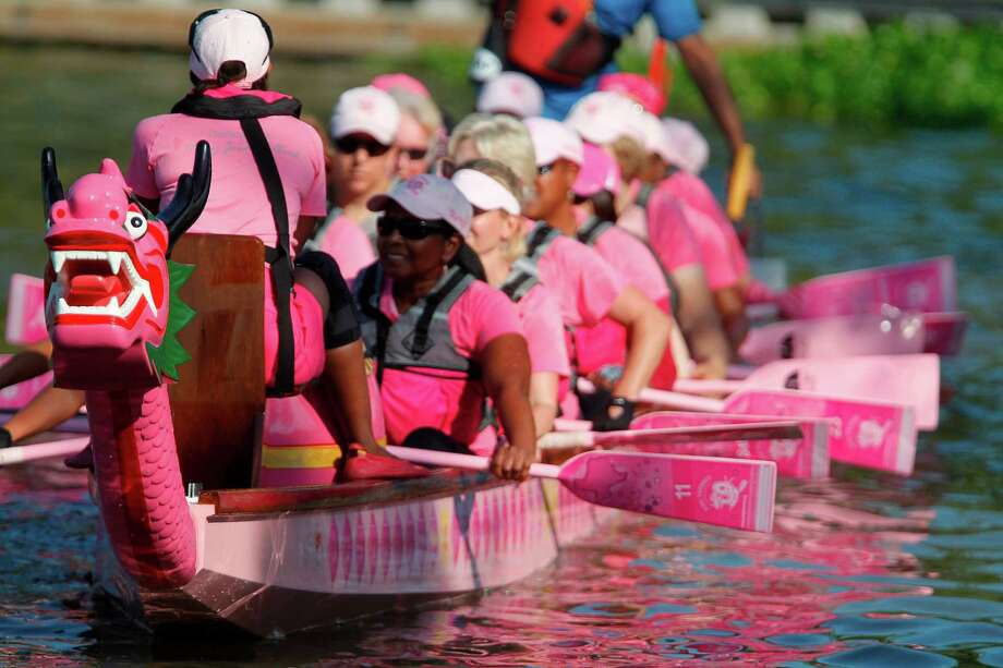 Pink Phurree is a breast cancer survivor dragon boat team, and they now have their own pink dragon race boat. Photo: Mayra Beltran, Houston Chronicle / © 2012 Houston Chronicle