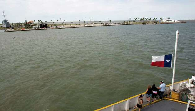 Passengers move about the deck of the Bolivar Ferry as is passes Pelican Island's Seawolf Park. The island's 3,500 acres are also home to Texas A&M University at Galveston. The port director for Galveston says cruise lines would take advantage of a rail connection. Photo: Brett Coomer / © 2012 Houston Chronicle