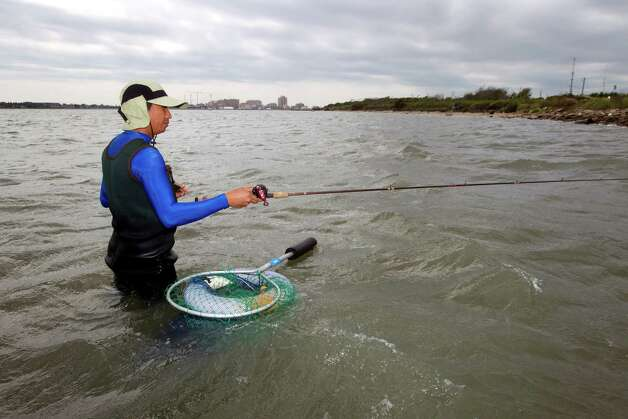 Jerry Cajelo fishes just off the beach on Pelican Island last week. The island is known as a good place to catch flounder and other fish. Some fear coal shipping could end that. Photo: Brett Coomer / © 2012 Houston Chronicle
