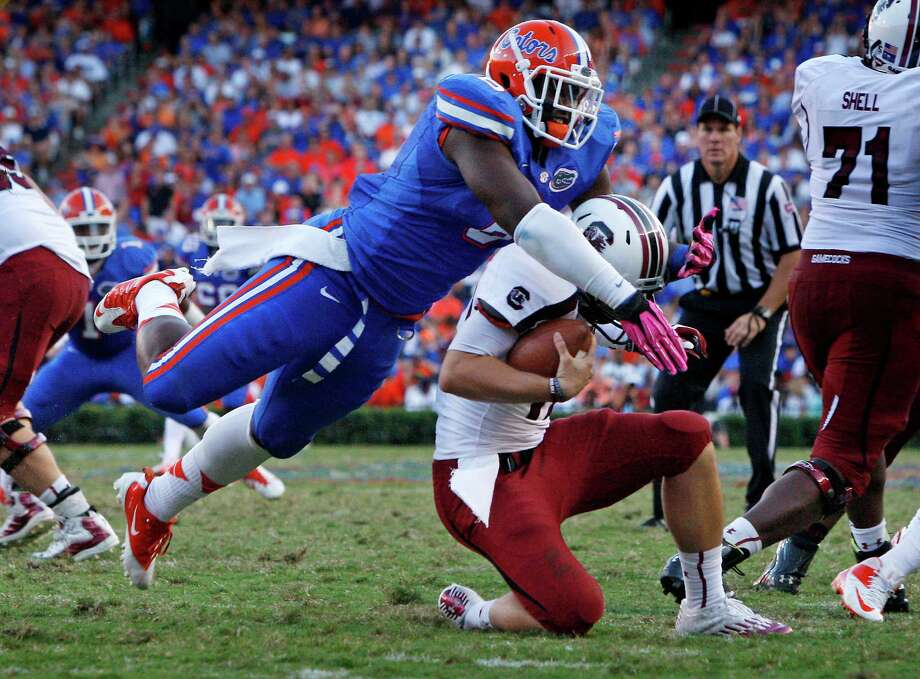 Florida's Dante Fowler Jr. engulfs South Carolina quarterback Dylan Thompson. Photo: Gerry Melendez / The State