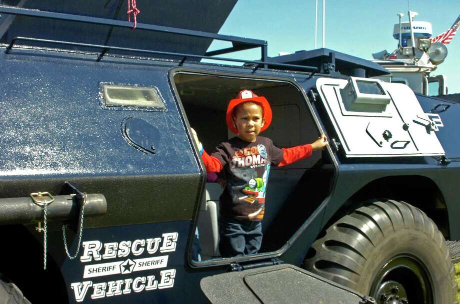 Jacob Guidry, 5, of Beaumont explores a Jefferson County Sheriff's Office SWAT vehicle at Saturday's Touch a Truck event, hosted by the Beaumont Children's Museum. Photo: Sarah Moore