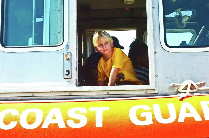 Ty Landry, 4, of Sour Lake, enjoys the view from a Coast Guard patrol boat, which was one of many ve