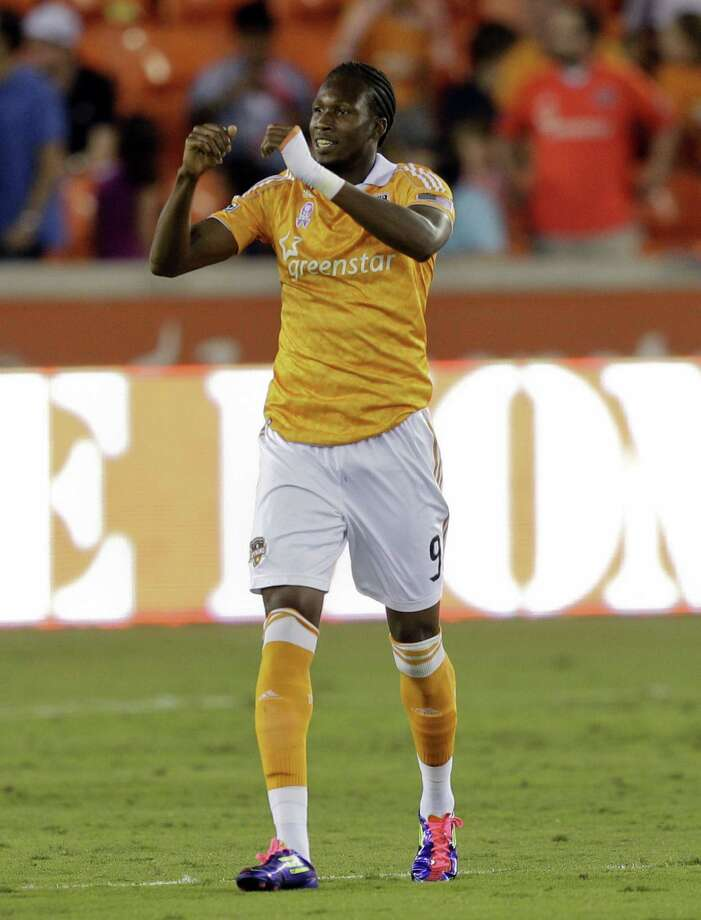 HOUSTON,TX - OCTOBER 20:  Macoumba Kandji #9 of the Houston Dynamo celebrates after scoring in the first half against the Philadelphia Union at BBVA Compass Stadium on October 20, 2012 in Houston, Texas. Photo: Bob Levey, Getty Images / 2012 Getty Images