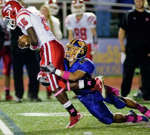 Masuk High School quarterback Malik Cummings is taken down by Brookfield High School's Casey Burdick during a game played at Brookfield. Saturday, Oct. 20, 2012 Malik Cummings tackle  against Brookfield High School Photo: Scott Mullin / The News-Times Freelance