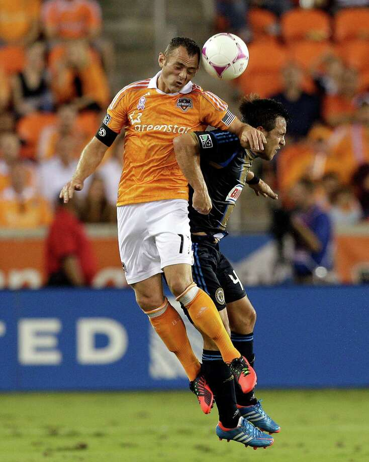 HOUSTON,TX - OCTOBER 20: Brad Davis #11 of the Houston Dynamo hits Danny Cruz #44 of the Philadelphia Union as he heads the ball away in the first half at BBVA Compass Stadium on October 20, 2012 in Houston, Texas. Photo: Bob Levey, Getty Images / 2012 Getty Images