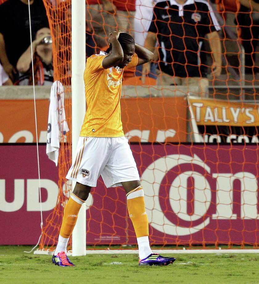 HOUSTON,TX - OCTOBER 20: Macoumba Kandji #9 of the Houston Dynamo reacts after missing a goal opportunity against the Philadelphia Union in the first half  at BBVA Compass Stadium on October 20, 2012 in Houston, Texas. Photo: Bob Levey, Getty Images / 2012 Getty Images