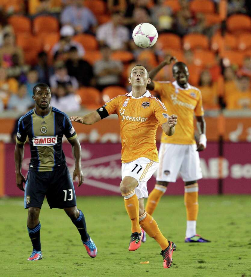 HOUSTON,TX - OCTOBER 20:  Brad Davis #11 of the Houston Dynamo controls  the ball as Michael Lahoud #13 of the Philadelphia Union looks on at BBVA Compass Stadium on October 20, 2012 in Houston, Texas. Photo: Bob Levey, Getty Images / 2012 Getty Images