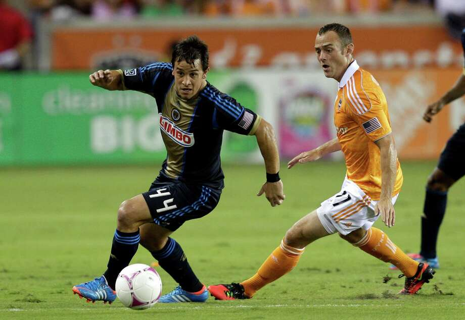 HOUSTON,TX - OCTOBER 20:  Danny Cruz #44 of the Philadelphia Union brings the ball up field as Brad Davis #11 of the Houston Dynamo defends at BBVA Compass Stadium on October 20, 2012 in Houston, Texas. Photo: Bob Levey, Getty Images / 2012 Getty Images